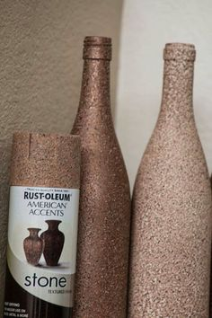 Spray wine bottles with stone textured paint