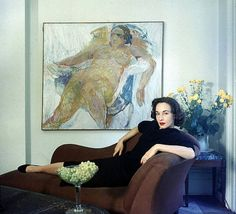 Artist and part time fashion model Jane Wilson poses in front of one of her works, photo by Gordon Parks, New York 1957