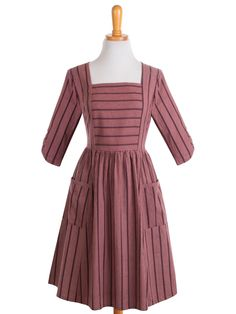 Burgundy is the Pantone color of the year, and an elegant way to wear is with this retro-style handmade dress. Wear it with cognac color accessories to finish this unique look. - pockets at the hip -