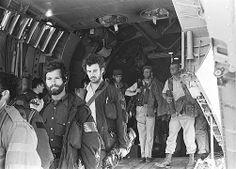 Delta Force operators board a C-141.