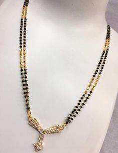 Black beads mangalsutra| black beads chain Indian | black beads | black beads chain | black beads Malla pusalu | black beads models in gold | black beads designs in gold 1 Gram Gold Jewellery, Gold Jewelry, Black Gold, Beaded Necklace, Jewels, Chain, Beads, Rings, Indian