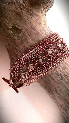 This untreated copper chainmaille bracelet has polished gemstone beads of rose quartz and moonstone, as well as an antiqued copper d-ring toggle.