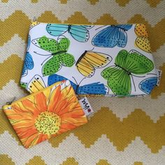 """NWOT Clinique Cosmetic Bags Bundle It's spring! Time to refresh those dirty makeup bags! Two Clinique cosmetic bags with pretty butterfly and floral patterns by artist Vera Neumann. Adorable ladybug lining in both bags! New without tags- never been used. Approximate measurements: H 6"""" x L 10"""" x W 2.75"""" and smaller bag H 3.5"""" x W 5.25"""". 100% polyester. Clinique Bags Cosmetic Bags & Cases"""