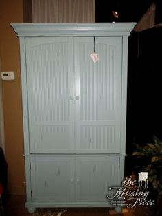 "Shutter door entertainment armoire in a distressed aqua. Love this color! Nice fresh look. There is space for a TV above and two shelves behind the doors below. The doors are hinged to go back. 45""W x 24""D x 74""H."