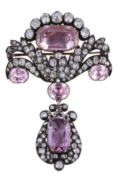 An early Victorian pink topaz and diamond brooch/pendant, circa The foiled closed back settings set with oval and mixed cut pink topazes, in gold closed collets, within a scrolled foliate old mine cut diamond set pediment, with a similar set lyre sha Sparkly Jewelry, Old Jewelry, Antique Jewelry, Vintage Jewelry, Fine Jewelry, Jewelry Box, Pink Bling, Pink Topaz, Art Nouveau