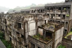 This abandoned building complex used to stand in the Zhongzheng district of Keelung city in northeastern Taiwan. The residential buildings were left unfinished and had been slowly overtaken by nature.   According to flickr user cock_a_doodle who took these spectacular photos, the buildings which resemble Hashima, the ghost island of Japan, were demolished before 2012.