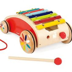 This beautifully crafted Wooden Xylophone Pull Along Roller from Janod is certain to be a hit with all budding musicians! As well as being a xylophone with 8 colourful note bars, it is also a pull along cart style toy. Toddler Toys, Kids Toys, Toddler Gifts, Tatoo Music, Musical Toys For Kids, Kids Toy Store, Pull Along Toys, Instruments, Wooden Baby Toys
