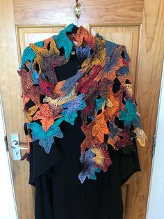 Falling leaves and the golden hues of autumn are the inspiration for this free-form shawl, composed of individual leaves in a one-of-a-kind design.