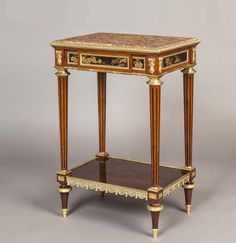 OnlineGalleries.com - An Antique Side Table in the Louis XVI Manner By Henry Dasson of Paris