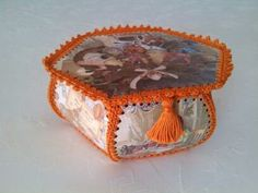 Crochet box with sewing related pictures and orange crochet