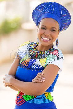 young south african zulu woman in traditional clothes portrait outdoors - stock photo young south african zulu woman in traditional clothes portrait outdoors - stock photo African Attire, African Wear, African Women, African Dress, African Clothes, Zulu Traditional Attire, African Traditional Wedding, Traditional Outfits, African Fashion Designers