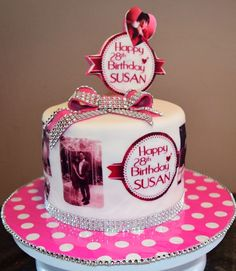 Pink Moscato Strawberry cake with Pink Chocolate Strawberry ganache.  Edible images and diamante ribbons.