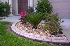 front yard flower bed ideas lava rocks | Rock-Flower-Bed ...