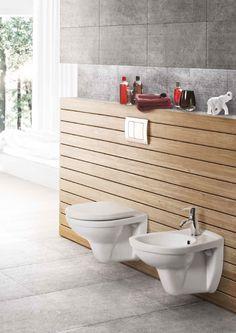 Naturalne materiały (takie jak drewno i kamień) oraz stonowane barwy (szarość, biel) tworzą relaksującą atmosferę w łazience.