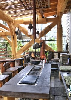 アウトドアリビングの囲炉裏 Irori, Garden Swing Seat, Resort Interior, Bbq Table, Japan Architecture, Japanese Interior Design, Garden Living, Japanese House, Outdoor Cooking