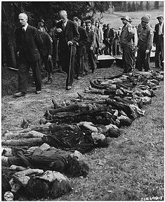 Collective guilt: US troops force German civilians to walk past the lined-up corpses of 30 Jewish women starved to death by the SS.