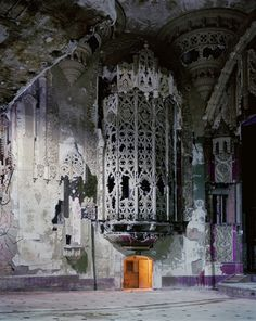 """""""american gothic"""" detroit, michigan (Andrew Moore, For perspective, that's a doorway at the bottom of the iron cage. Part of the crumbling United Artists Theater in Detroit, Michigan. Abandoned Buildings, Abandoned Asylums, Old Buildings, Abandoned Places, Abandoned Castles, Beautiful Architecture, Beautiful Buildings, Beautiful Ruins, Beautiful Places"""