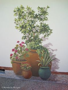 Patio pots trompe l'oeil mural. This is a very clever way to make a small terrace look larger.
