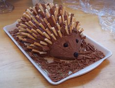 Porcupine (or Hedgehog) cake. Recipe from Invitation to Dine. Assemble with 3 pkgs ladyfingers, chocolate buttercream, toasted slivered almonds, raisin eyes & nose. Hedgehog Cookies, Hedgehog Cake, 8th Birthday Cake, Happy Birthday Boy, Cupcakes, Cupcake Cookies, Porcupine Cake, Chocolate Buttons, Baking Business