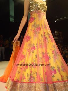 A gorgeous Anarkali suit with sequences with kali with floral prints with transparent layer fabric with border with dupatta