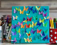 painted paper, punched butterflies, folded and adhered to painted canvas