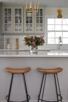 LOVE THIS COLOUR SCHEME - THE SOFT DOVE GRAY WITH THE GLEAMING WHITE MARBLE TOPS AND SUBWAY TILES.