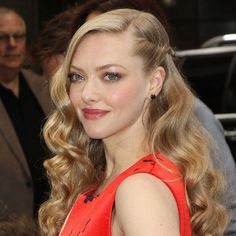 Twist one side of your hair back like Amanda Seyfried for an updated wavy 'do.