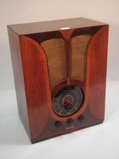 A 1937 Philco walnut veneered radio in the Art Deco style with bakelite knobs