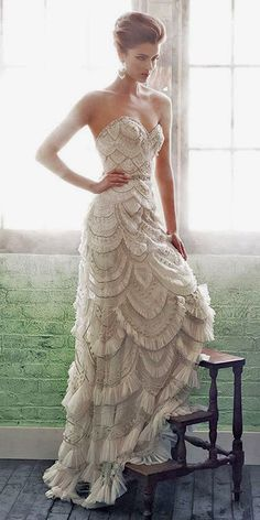 The sweetheart neckline is a versatile one. Definitely far from the rustic crowd, you'll find some incredible artistic showstoppers, just like this embellished, scalloped wedding dress. The organic shape of the neckline and simple cut keep the whole effect from being over the top - perfect for an art deco wedding.