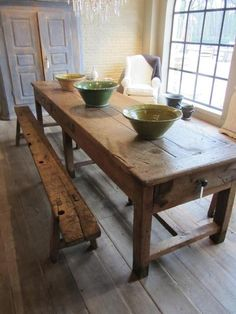 old wood farmhouse table and bench with mom and dad chairs on each end, with 10 kids on the benches. What a childhood memory.