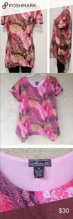 Asymmetrical pink top Beautiful pink color asymmetrical tunic top . Size tag says 1x but would be perfect for 2x-3x.  Measures Armpit to armpit :23  length longest side :33 shortest side : 30.🎯 100% polyester . Fully lined. Tops