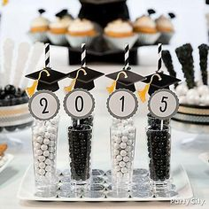 They graduated, sweet! Highlight this moment by filling small cordial glasses with black & white Sixlets®. Use small lollipops covered with candy buffet labels to make the 2015!