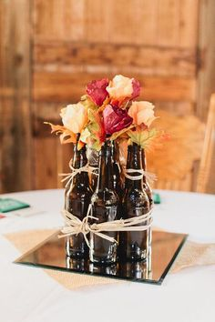 I mean, how AWESOME are these beer bottles used as centerpieces? {Andrew + Jade [Photography]}