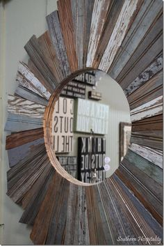 Seen a lot of sunburst mirrors - but love this with the old beadboard.  Beautiful!