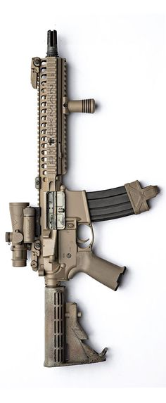 Noveske upper, BCM, Magpul furniture and sights, Browe Gear Sector VFG, and AAC. 18 tooth can mount for maximum fun. By Stickman.