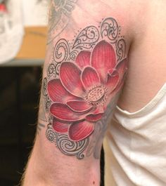 Colour lotus flower with filigree designs from Janis Kinens at hammersmith tattoo!!
