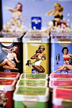 Pin-up tea tins.