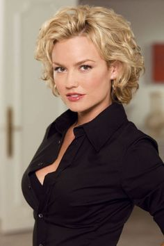 Some Pictures About Hairstyles For 40 Year Old Woman That You Should Know And Try : Short Curly Hairstyles For Women Over 40 This Style Is Using Side Parted And The Hair Is Just Freely Fall Make A Natural Wavy For The Impression