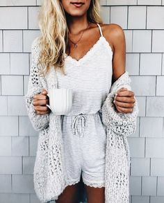 Gray cardigan over all white.