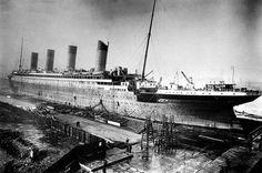 View of Titanic in the fitting-out berth following her launch, the final stages of construction and outfitting were carried out here.