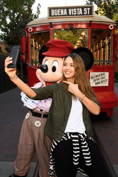 Jessica Alba Photos Photos - In this handout photo provided by Disney Parks, Actress Jessica Alba takes a ride with Mickey Mouse on the Red Car Trolley at Disney California Adventure Park on March 31, 2017 in Anaheim, California. - Jessica Alba and Her Family Visit Disney California Adventure