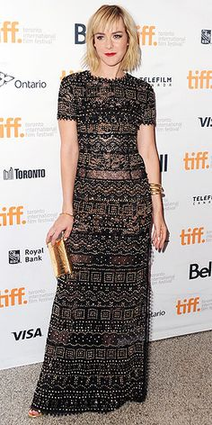All the Looks from the Toronto Film Festival | JENA MALONE | Though studs and delicate lace may seem like contrasting elements for a red carpet gown, the actress proves they can play well together, as seen on her rocker-chic Emilio Pucci dress. She adds gold accessories and a red lip for the Time Out of Mind premiere.