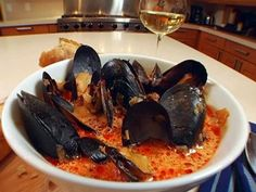 Spicy Mussels with Chorizo and Wine from FoodNetwork.com, made this tonight and it was delicious! can sub shrimp for mussels if needed