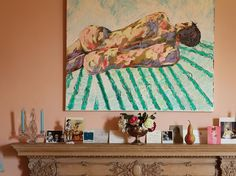 A painting by Langmead hangs over the mantel in the sitting room.