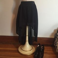 Black skirt A no boundaries black high-low skirt with slip sewn on the inside and the lower portion is sheer. Very versatile to style for both winter and summer fashions No Boundaries Skirts High Low