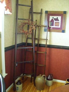 I need a ladder for storing throws in the living room.  6 foot Primitive Wooden Authentic Apple Picking Orchard Ladders. $132.00, via Etsy.