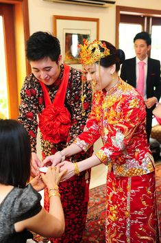 Bride and groom in traditional Chinese suit and qun kua with gold headdress // KC and Meilan's Blissful Resort Wedding
