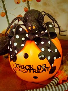 Pumpkin from Michaels,  Polka Dot Ribbon, vinyl dots and Trick or Treat cut with Cricut machine