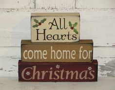 This All Hearts Come Home For Christmas primitive wood stacking blockset will make a nice shelf sitteraccent for your Christmasand winter holiday home décor.I have painted this set buttermilk,spice tan and barn redwith black underneath the topcoat formore of a primitive look. I added accents of snowflakes and holly and berries.  They have been distressed over the entire blocks. Measures approx. 9 x 10 wide