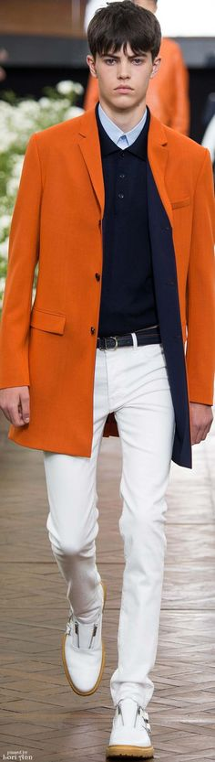 Dior Homme Spring 2016. men's spring outfit. navy button down sweater, orange overcoat, white pants, white shoes.